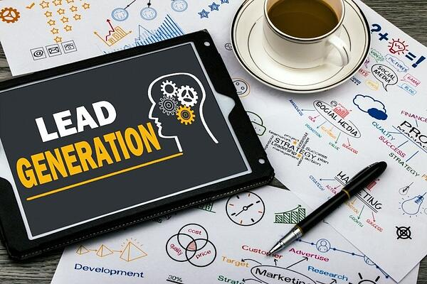 "flow charts and an ipad with an image reading ""lead generation"""