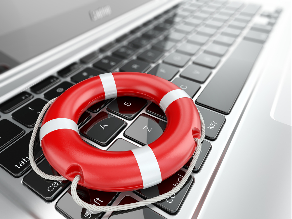 open laptop with a lifeguard safety ring on keyboard